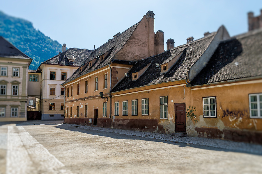 View of Curtea Honterus Street in the town of Brasov in Romania.