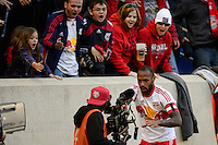 Thierry Henry (14) of the New York Red Bulls plays with a TV camera after scoring a goal. The New York Red Bulls and the Colorado Rapids played to a 1-1 tie during a Major League Soccer (MLS) match at Red Bull Arena in Harrison, NJ, on March 15, 2014.
