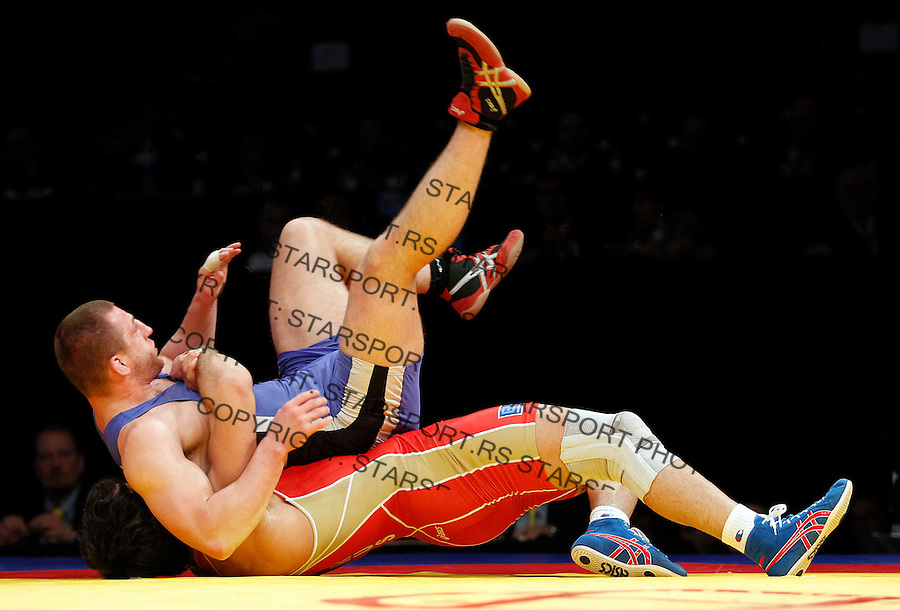 BELGRADE, SERBIA - MARCH 09: Anzor Urishev of Russia (DOWN) fights with Armands Zvirbulis of Latvia (TOP) during Men`s  Freestyle 84 kg match for bronze medal at the European wrestling championship March 09, 2011 in Belgrade, Serbia.(Photo by Srdjan Stevanovic/Getty Images)