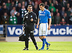 St Johnstone v Celtic...07.05.14    SPFL<br /> An injured Gary Miller leaves the pitch<br /> Picture by Graeme Hart.<br /> Copyright Perthshire Picture Agency<br /> Tel: 01738 623350  Mobile: 07990 594431