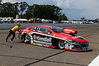 Aug 16, 2014; Brainerd, MN, USA; A member of the Safety Safari pushes NHRA pro stock driver V. Gaines off the track during qualifying for the Lucas Oil Nationals at Brainerd International Raceway. Mandatory Credit: Mark J. Rebilas-