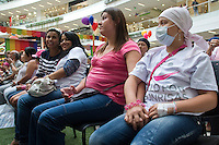 Laura Sanchéz (R) waits for her new wig during a donation ceremony as a commitment to actively fight against cancer in Medellin, Colombia, May 25, 2012.  Colombia celebrated on 31 January, 7, 14 and 21 February some days of donating hair in Beauty Centres Fundayama ALQVIMIA and foundation (Foundation for support and support people with breast cancer), it received 300 donations of hair with which they made 200 wigs  Photo by Fredy Amariles/View