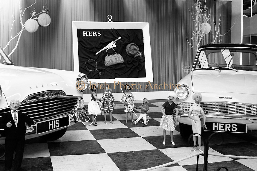 The must-have &lsquo;His&rsquo; and &lsquo;Hers&rsquo; cars of 1961 at the Henry Fords stand at the RDS: a Zodiac for him; an Anglia for her..02.05.1961