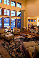 Interior view of great room with the blue light of dusk seen outside. Luxury home located in Fort Collins, Colorado.
