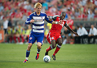 FC Dallas defender/midfielder Brek Shea #20 and Toronto FC defender Eddy Viator #55 in action during an MLS game between the FC Dallas and the Toronto FC at BMO Field in Toronto on July 20, 2011.