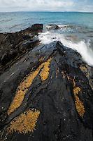 Waves break across a rocky reef at Deep Creek Conservation Park, South Australia.