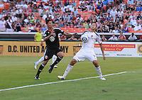 LA Galaxy defender Omar Gonzalez (4) defends the play against DC United forward Pablo Hernadez (21)  LA Galaxy defeated DC United 2-1 at RFK Stadium, Saturday July 18, 2010.