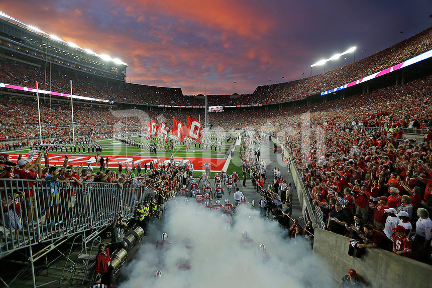 Ohio State Buckeyes players enter the stadium before their game against Virginia Tech Hokies in Ohio Stadium on September 6, 2014.  (Dispatch photo by Kyle Robertson)