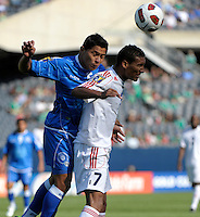 El Salvador's Victor Turcios heads the ball over Cuba's Marcel Hernandez.  El Salvador defeated Cuba 6-1 at the 2011 CONCACAF Gold Cup at Soldier Field in Chicago, IL on June 12, 2011.