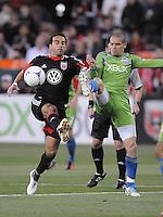 D.C. United forward Dwayne De Rosario (7) goes against Seattle Sounders midfieler Osvaldo Alonso (6)  D.C. United tied the Seattle Sounders, 0-0 at RFK Stadium, Saturday April 7, 2012.