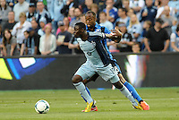 KANSAS CITY, KS - June 1, 2013:<br /> Peterson Joseph (19) midfield Sporting KC marked by Patrice Bernier (8) midfield Montreal Impact .<br /> Montreal Impact defeated Sporting Kansas City 2-1 at Sporting Park.