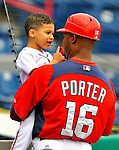 7 March 2012: Washington Nationals 3rd Base Coach Bo Porter holds his son Bryce Porter after a game against the St. Louis Cardinals at Space Coast Stadium in Viera, Florida. The teams battled to a 3-3 tie in Grapefruit League Spring Training action. Mandatory Credit: Ed Wolfstein Photo