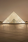 France, Paris, Louvre Museum, Louvre Pyramid, illuminated at night. License this image for commercial, advertising and editorial usages through Getty Images. Image number 200429493-001
