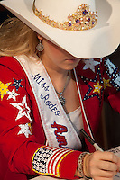 Mackenzie Carr, Miss Rodeo America 2012 signs autographs at RodeoHouston in 2012.