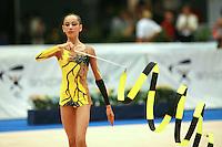 Darya Kushnerova of Ukraine circles ribbon before routine begins at 2006 Portimao World Cup of Rhythmic Gymnastics on September 10, 2006 at Portimao, Portugal.  (Photo by Tom Theobald)
