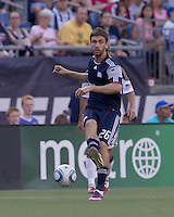 New England Revolution midfielder Stephen McCarthy (26) passes the ball. In a Major League Soccer (MLS) match, the Philadelphia Union defeated the New England Revolution, 3-0, at Gillette Stadium on July 17, 2011.