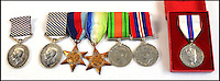 BNPS.co.uk (01202 558833)<br /> Pic: AdamPartridge/BNPS<br /> <br /> (L to R) Sgt Leach's DFM, Sgt Chapman's DFM, 1939-1945 star, the Atlantic Star, the Defense Medal, the War Medal 1939-1945 and the Queen Elizabeth II Silver Jubilee Medal.<br /> <br /> The little-known story of a heroic Second World War pilot and navigator duo who were the real life version of Maverick and Goose from 80s film Top Gun has emerged after more than 70 years.<br /> <br /> Sergeants Denys Chapman and Kenneth Leach were both awarded a Distinguished Flying Medal - one of the air force's top awards - for their bravery fighting enemy aircraft in the 1940s.<br /> <br /> Unusually, Sergeant Leach got his when Command tried to give a second DFM to Sgt Chapman but he refused and insisted it go to his flying buddy for saving his life. <br /> <br /> The rare and important medals are now going up for sale together with Adam Partridge Auctioneers in Macclesfield, Cheshire.