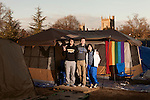 January 23, 2013. Durham, North Carolina. (left to right) Richard Wang, TJ Ciesla and Harmony Zhang, all freshmen, stand at their tent in K-Ville where students camp out to get tickets for home basketball games at Cameron Indoor Stadium. Students stay for weeks leading up to the game versus arch rival UNC.. Duke University has become a power house in the national college basketball arena under the coaching of head coach Mike Krzyzewski. But the university has fought hard to maintain its image of high academic achievement while riding the wave of collegiate athletic success.