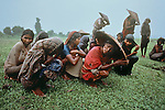 Tea leaf pickers in the rain. Sylhet, Bangladesh, 1983.<br />