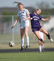 NWA Democrat-Gazette/J.T. WAMPLER Fayetteville's Myra Tubb and Bentonville's Sydney Suggs vie for the ball Friday April 14, 2017 at Bentonville. The Tigers won 1-0 and are 8-0 for the season.