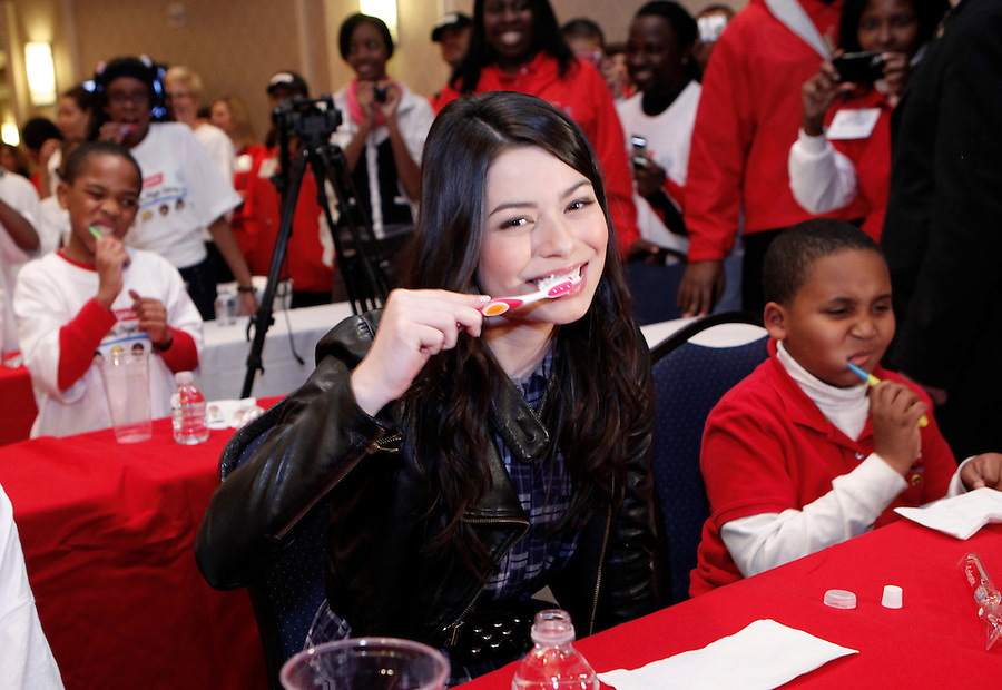 "Actress and musician Miranda Cosgrove participates in a ""brush-a-thon"" as she attends a Colgate event, ""100 million smiles Celebration"" in New York October 27, 2009. Natalie Behring / AP for Colgate-Palmolive Company"