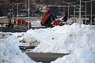 Washington, DC - January 25, 2016: After removing snow from city streets, work crews from around the District of Columbia deliver tons of snow to an RFK Stadium parking lot January 25, 2016, after Winter Storm Jonas dumped an average of 20 inches of snow on the city. The storm officially ranked in the city's Top 5 for snow fall. (Photo by Don Baxter/Media Images International)