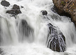 Water rushes over rocks at Firehole Falls in Yellowstone.