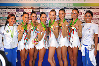 September 12, 2009; Mie, Japan;  Posing with coaches the Italian rhythmic group wins gold in group All Around at the 2009 World Championships Mie, Japan. (L-R) Romina Laurito, Elisa Blanchi, Daniela Masseroni, Anzhelika Savrayuk, Giulia Galtarossa, Elisa Santoni. Photo by Tom Theobald .