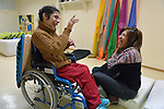 Micaela Torrero (left) laughs as she talks with Margot Birriel in a multi-sensory room at the Instituto de Buena Voluntad (the Good Will Institute) in Montevideo, Uruguay. Sponsored by the Methodist Church of Uruguay, the institute works with youth and adults with disabilities. Birriel is a technical advisor to the institute, which receives financial support from United Methodist Women. Outside the room, Torrero spends much of her time in her wheelchair.