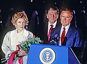United States Vice President George H.W. Bush, right, introduces U.S. President Ronald Reagan, center, at a ceremony at Andrews Air Force Base, just outside of Washington, D.C. following the President's return from the Moscow Summit on June 3, 1988. First lady Nancy Reagan is at left.<br /> Credit: Arnie Sachs / CNP