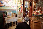 Near Tiberias. A man prays in a Greek orthodox church. Much of the ministry of Jesus occurred on the shores of Kinneret or Sea of Galilee.