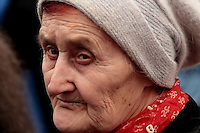Old woman attending a Communist Party rally in Kiev, Ukraine, 2008