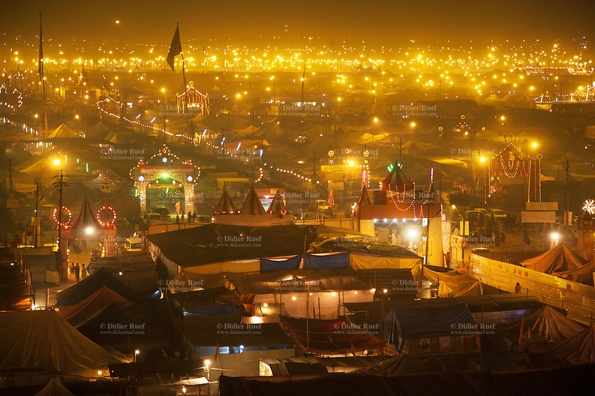 India. Uttar Pradesh state. Allahabad. Maha Kumbh Mela. Tents and guru's wards are illuminated at night in Sangam. The Kumbh Mela, believed to be the largest religious gathering is held every 12 years on the banks of the 'Sangam'- the confluence of the holy rivers Ganga, Yamuna and the mythical Saraswati. The Maha (great) Kumbh Mela, which comes after 12 Purna Kumbh Mela, or 144 years, is always held at Allahabad. Uttar Pradesh (abbreviated U.P.) is a state located in northern India. 13.02.13 © 2013 Didier Ruef