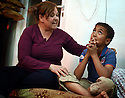 TRAUMA HEALING CASE STUDIES. MARGARET KHABBAZ, TRAUMA HEALING FACILITATOR FOR BIBLE SOCIETY SITS WITH EIGHT YEAR OLD TARIQ, IRBID, JORDAN. 20/4/16. PHOTO BY CLARE KENDALL.