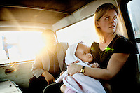 Cecilie holds Victoria as they travel to a private clinic in Kathmandu. For the first time in her life Victoria breathes fresh air, sees the blue sky and hears the noises of the outside world. 19 month old Victoria (formerly named Ghane) was born with hydrocephalus and was left abandoned. Cecilie Hansen was so moved by the story of Ghane she read in a Danish newspaper that she decided to fly to Kathmandu to try to assist her and show her the love of another human being; Cecilie eventually became her legal guardian. Victoria died on November 19 2010 from heart failure.