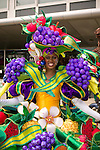 A woman shows off her outfit covered with fake fruit before the start of the parade for the ZomerCarnaval (Summer Carnival) in Rotterdam, the Netherlands. The street parade is the colorful high point of the Rotterdam carnival. It is a tropical themed parade with over 2000 participants and travels 6km through the center of Rotterdam.