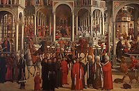 Detail from Episodi della vita di San Marco, or Scenes from the Life of St Mark, 1525-26, Renaissance painting by Giovanni Mansueti, 1465-1527, in the Gallerie dell'Accademia, Venice, Italy. The scene is set in a square in Alexandria, with Venetian inspired architecture and crowds of European and Mamluk men. On the right, the sultan commands the arrest of St Mark, he is arrested in a church in the rear centre, and on the left, St Mark is visited in prison by Christ and an angel. This was 1 of 3 paintings completed by Mansueti for the Scuola Grande di San Marco. Picture by Manuel Cohen