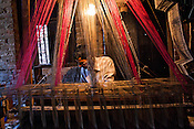 Md. Naim is one of the few muslim weavers using traditional looms to weave famous Benaresi saris in his workspace in Gazi Sadullahpura Bade Bazaar in Varanasi in Uttar Pradesh, India. Photograph: Sanjit Das/Panos