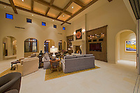 Mediterranean type family room with high beamed ceilings and small clerestory windows