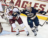 Steven Santini (BC - 6), David Gerths (ND - 10) - The visiting University of Notre Dame Fighting Irish defeated the Boston College Eagles 7-2 on Friday, March 14, 2014, in the first game of their Hockey East quarterfinals matchup at Kelley Rink in Conte Forum in Chestnut Hill, Massachusetts.