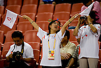 A Chinese fan sings to one of the official olympic songs before the game at Worker's Stadium.  The USWNT defeated Japan, 4-2, during the semi-finals of the Beijing 2008 Olympics in Beijing, China.
