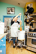 Hillsborough, North Carolina - Thursday March 10, 2016 - April McGreger makes marmalade in the kitchen of her home in Hillsborough.