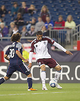 Colorado Rapids forward Caleb Folan (21) attempts to control the ball as New England Revolution defender Kevin Alston (30) closes. In a Major League Soccer (MLS) match, the New England Revolution tied the Colorado Rapids, 0-0, at Gillette Stadium on May 7, 2011.