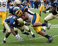 30 September 2006: Toledo tight end Chris Hopkins collides with Pitt defensive back Kennard Cox (5).  The Pitt Panthers defeated the Toledo Rockets 45-3 on September 30, 2006 at Heinz Field, Pittsburgh, Pennsylvania.