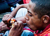 A man smokes marijuana in a pipe as he takes part in a rally to support Marijuana decriminalization in Buenos Aires, Argentina May 4, 2013. Photo by Juan Gabriel Lopera / VIEWpress.
