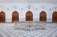 Fountain surrounded by a star shaped balustrade in the courtyard of the Jamaa el Kebir or Great Mosque, 19th century, in the medina or old town of Tetouan, on the slopes of Jbel Dersa in the Rif Mountains of Northern Morocco. Tetouan was of particular importance in the Islamic period from the 8th century, when it served as the main point of contact between Morocco and Andalusia. After the Reconquest, the town was rebuilt by Andalusian refugees who had been expelled by the Spanish. The medina of Tetouan dates to the 16th century and was declared a UNESCO World Heritage Site in 1997. Picture by Manuel Cohen