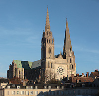 Western facade and North transept of Chartres cathedral, a Gothic cathedral built 1194-1250, with a 105m plain pyramid spire built c. 1160, a 113m early 16th century spire on top of an older tower, and the Western rose window, made c. 1215 and 12m in diameter, Eure-et-Loir, France. Chartres cathedral was declared a UNESCO World Heritage Site in 1979. Picture by Manuel Cohen