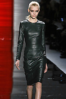 Josesphine walks runway in a hunter green long-sleeved leather sheath dress with trapunto-stitch details, from the Reem Acra Fall 2012 Feminine Power collection fashion show, during Mercedes-Benz Fashion Week New York Fall 2012 at Lincoln Center.
