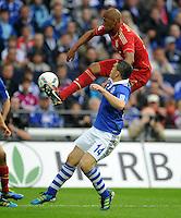FUSSBALL   1. BUNDESLIGA   SAISON 2011/2012    6. SPIELTAG FC Schalke 04 - FC Bayern Muenchen                       18.09.2011 Jerome BOATENG (hinten, Bayern) gegen Kyriakos PAPADOPOULOS (vorn, Schalke)