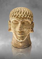 First half of the 6th century B.C Etruscan clay head of a young man made in Chiusi, inv 94612, National Archaeological Museum Florence, Italy , grey art background